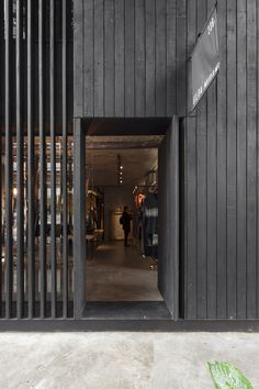 The inside of this store in São Paulo is entirely fair-faced concrete. The façades were finished in carbonized wood boards and slats. Concrete Facade, Wood Facade, Concrete Architecture, Concrete Wood, Architecture Details, Interior Architecture, Wood Wood, House Cladding, Timber Cladding