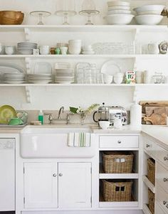 Small Space Storage Ideas: Use open shelving or remove cabinet doors to visually expand the kitchen. Store items in decorative baskets and bins or neatly display them on the shelves.