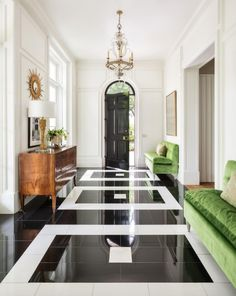 Accents of green with the black granite and white marble floor make a statement in this chic entry foyer. Accents of green with the black granite and white marble floor make a statement in this chic entry foyer. Design Entrée, Floor Design, Tile Design, Sofa Design, House Design, Design Ideas, Furniture Design, Graphic Design, Foyer Flooring
