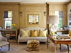 Paneled walls and gorgeous French settee...and  a little pop of animal in the ottoman
