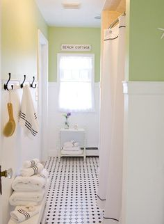 Ooo, I like the wainscoting and the paint color and the tile floors and the black hangers!