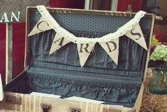 A burlap banner by ColorSplashDesign will look great with a vintage suitcase to place your cards in. 12 Beautiful Burlap Ideas on @intimatewedding #vintagewedding