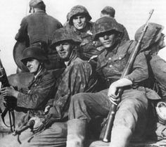 Estonian Waffen-SS volunteers hitching a ride atop a tank