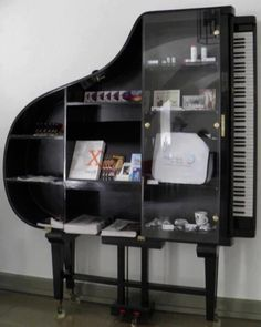 grand bookcase. Upcycled piano