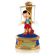 """Disney Pinocchio When You Wish Upon a Star Ornament.  75th Anniversary.  Battery operated. Battery included.  Push a button to hear a snippet of """"When You Wish Upon a Star.""""   Available:  October 2015  $22.95"""