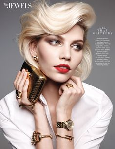 fregole.com #fregole #gold #blonde Aline Weber shows off a short coif in this jewelry story featured in Harper's Bazaar US's March edition. The blonde shines for the lens of Amy Troost in a mix of gold jewelry worn with a classic button-up shirt styled by Alastair McKimm. Soft tresses by hair stylist Yannick D'ls and red lips courtesy of makeup artist Karan Franjola complete Aline's glam looks. / Manicure by Rica Romain