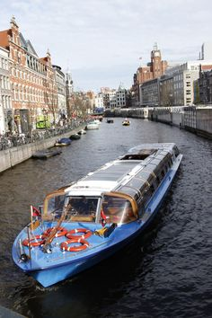 Amsterdam: tour the canals with a glass roofed boat, but beware the tourist mob!