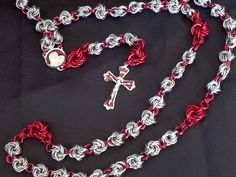 Silvertone and garnet chainmaille rosary beads by ~Nightwings-81 on deviantART