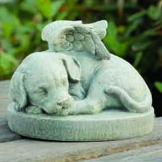 """Pet loss is difficult. When choosing a pet remembrance, honor your beloved dog with this precious garden figurine. The """"Puppy Wings"""" stone can be placed in a garden, on a porch or in your pet's favorite spot in your home.  Ideal to give as a pet sympathy gift for those whose 4-legged family member has gone to heaven and now has angel wings."""