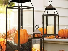 Show some Halloween spirit by adding pumpkins and candy corn to candle lanterns. This is a hassle-free way to decorate the outside of your home.
