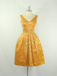 ~Quote: glorious gold for a glamorous gal = goodness     vintage 1950s dress~
