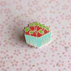 This sweet little basket of strawberries measures 1 wide and is hard enamel with…