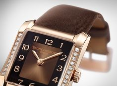 Discover the Baume & Mercier Hampton 10093 gold watch, set with diamonds and with a beautiful chocolate brown dial and satin strap.