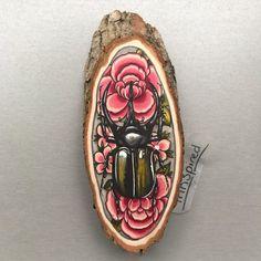 Wood slice with an original drawing of a atlas door Inkspirednl