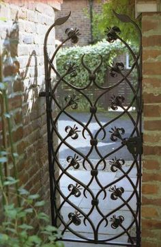 Tall gates are better for people with dogs; no small gaps to think about. This one has spikes to deter people climbing over. Metal Gates, Wrought Iron Gates, Door Gate, Fence Gate, Fences, Garden Entrance, Entrance Gates, Garden Gates And Fencing, Tor Design