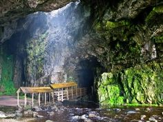 No, it's not actually a location from a video game. This is the spectacular Smoo Cave in Durness, Sutherland (Scottish Highlands). The cave is unique within the UK in that the first chamber has been formed by the sea, and the inner chambers by rainwater. Garden Of Cosmic Speculation, Places Around The World, Around The Worlds, Places To Visit Uk, Attraction World, Uk Landscapes, Vacation Pictures, Places Of Interest, Scotland Travel