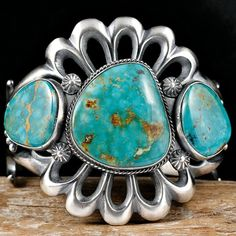 Cuff | Harrison Bitsue (Navajo). Sterling silver and Green Turquoise Mountain Turquoise on a sand cast or tufa cast bracelet..