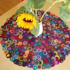 Felted circles table runner according​ blog spot. I think a rug would be quicker but similar to hooking.