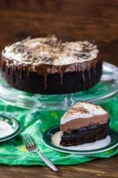 Irish Cream Coffee Mud Pie | Coffee turned into pie? Chocolate cookie crust, a flourless chocolate whiskey cake, a layer of chocolate espresso pudding, an Irish cream chocolate mousse, topped off with a sweet whipped cream - it's a chocoholic's dream!