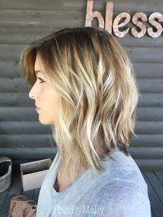 gorgeous choppy long bob with slightly inverted back