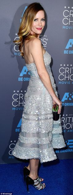 Sparkling and strapless: Leslie Mann radiated light in a sequin-studded strapless frock with fun strappy heels