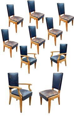 Charles Dudouyt, série de 8 chaises et 2 fauteuils en chêne et cuir