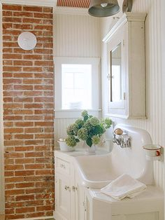 A salvaged wall-mount laundry sink in a renovated bath. See the rest of this home here: http://www.bhg.com/decorating/decorating-style/flea-market/patriotic-house-decor-ideas/?socsrc=bhgpin042212salvagedsink