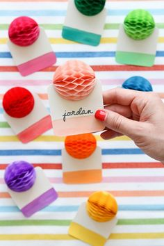 Put an extra pop into your escort cards with this DIY honeycomb balls.