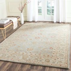 The elegant designs and rich colors of these rugs are inspired from 19th century antique Persian rugs. A special herbal wash gives these rugs their luster and an aged patina. This collection is hand tufted in India of 100% hand-spun premium wool.