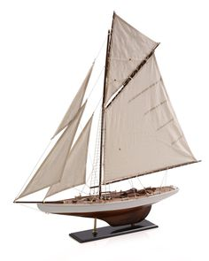 Crafted from wood, this decorative sailboat is the perfect piece to round out a a nautical theme.