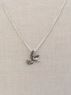This small hummingbird is perfect for everyday wear. Its sweet and simple in everyway. ----------------------------------------------------------------------------------------------- - Dimensions: 18mm long, 19mm wide - Also available with Box Chain; Chains are sterling silver with