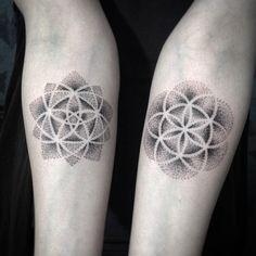 22. These matching mandala flower tattoos