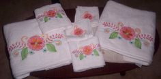 beautiful machine embroidery ideas, embroidery on towels, these designs are from Denim Delight by Julie hall designs,
