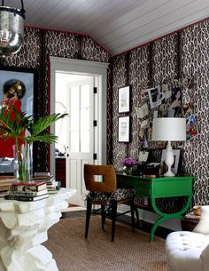 Bold pattern dominates the office designed by Peter Dunham. He upholstered the walls with a fabric of his own creation called Snow Leopard.