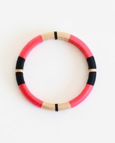 I think this would be a super simple DIY -- embroidery thread wrapped wooden bangle bracelet.