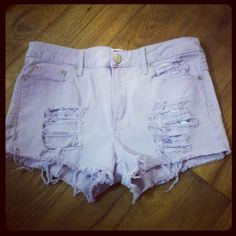 light purple shredded shorts