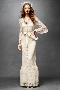 Undeniably bohemian, Tracy Reese's floor-length crocheted lace design is dotted with globe buttons and encircled by grosgrain at the waist. A keyhole nape makes for dramatic exits. Greenbow Lace Gown in SHOP The Bride Wedding Dresses at BHLDN. Hippie lace wedding dress.