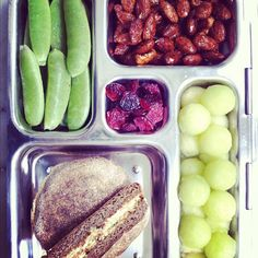 English muffin with veggie cream cheese, sugar snap peas, melon, dried cranberries and toasted almond. From weelicious.