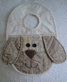 Patchwork dog´s face by Erika Patchwork, via Flickr---not sure what it is made for, but would make a DARLING bib!