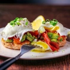 Salmon cakes, topped with smashed avocado, smoked salmon and poached eggs