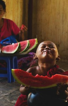 Enjoying a watermelon.