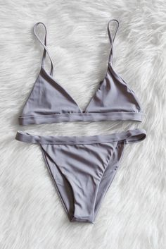 Seamless triangle bikini top with adjustable shoulder straps. Fully lined, not padded. Banded and seamless cheeky bikini bottoms.  80% Nylon 20% Spandex Made in USA  Returns will not be accepted for this item if the hygienic sticker has been peeled off.