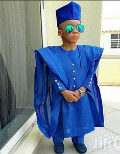 Hey Damsels, We take much pride in seeing our gents look stunning in their Agbada styles. We have seen some unbelievable creativity in Agbada-thanks to fashion savvy gents who have gone the extra m… Baby African Clothes, African Dresses For Kids, African Lace Dresses, African Children, Latest African Fashion Dresses, African Print Fashion, African Prints, African Babies, Ankara Fashion