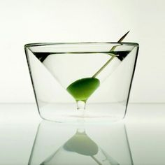 Double-walled glass, keeps your martini cold for much longer- low center of gravity makes it harder to tip over.