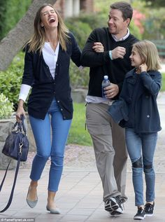 The funny bunch! Mark Wahlberg had his wife Rhea Durham howling with laughter on a walk with daughter Ella on Saturday in Los Angeles