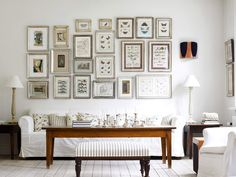 white intereror design | numerous pictures on white wall