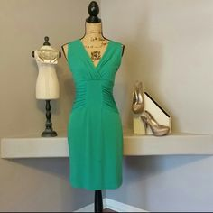 Calvin Klein Dress Emerald Green dress by Calvin Klein. Silky material that hugs every curve and shows a perfect hour glass figure.  Excellent condition! ! Calvin Klein Dresses