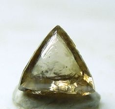 Diamond - in this state, it's much more lovely to me than cut and polished, with all it's natural beauty taken away.