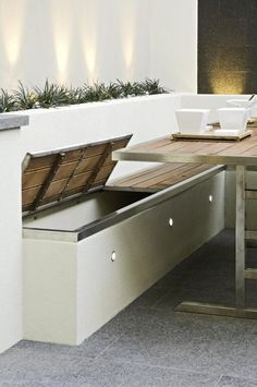 white rendered walls with planting beds contained within and built in storage benches