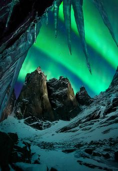 The aurora over enormous peaks in Canada's Yukon territory